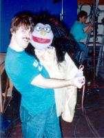 Terry Angus hugs Sydney the Witch puppet on set of Blizzard Island