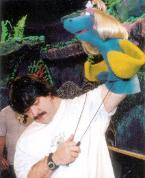 Terry Angus works fish puppet on set of 4 Fish Fly Free