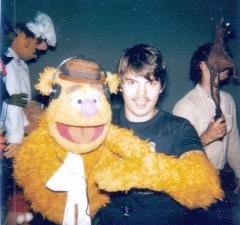 Terry Angus works Fozzie Bear puppet on set