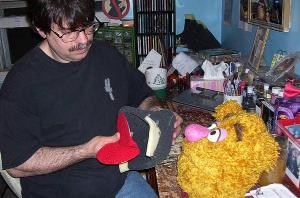Terry Angus in workshop building Fozzie poser puppet